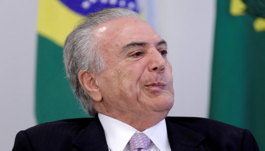 Brazil's President Michel Temer reacts during a signing ceremony of the New Decree of Port Regularization, at the Planalto Palace in Brasilia
